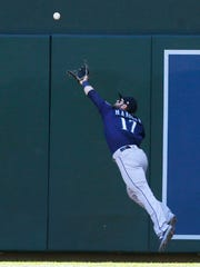 Mariners right fielder Mitch Haniger can't reach this first-inning double by Brian Dozier of the Twins.
