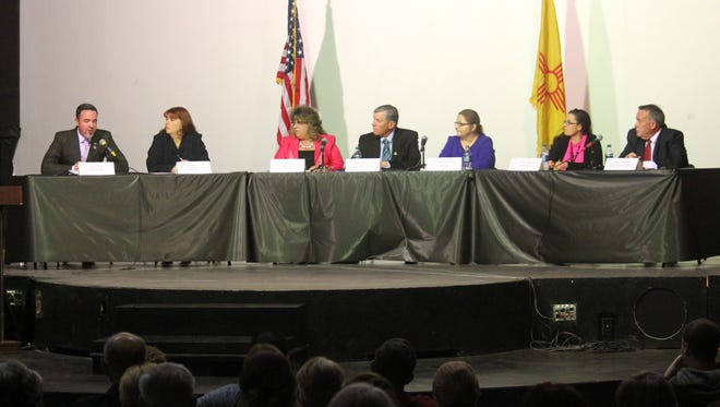 Candidates listen as Jason Baldwin, incumbent for District 1, speaks during the debate hosted by the Otero County Conservatives at the Historical White Sands Theatre on Thursday evening.