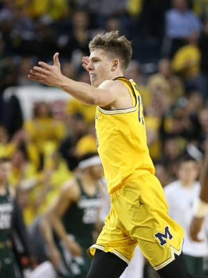 Michigan forward Moritz Wagner celebrates after a basket against Michigan State during the first half of U-M's 86-57 win over MSU Tuesday at Crisler Center.