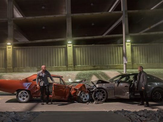 """This photo provided by Universal Pictures shows, Vin Diesel, left, as Dom Toretto, and Jason Statham as Deckard Shaw, in a scene from """"Furious 7."""" (AP Photo/Universal Pictures, Scott Garfield)"""