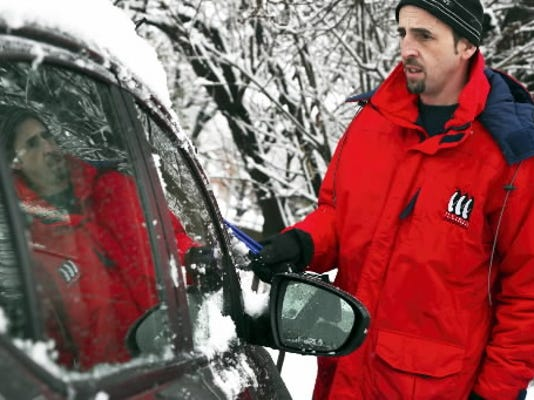 Jerry Young of Spring Garden brushes off the snow from his car after he was released early from York County Assistance Office, Monday, Feb. 3, 2014. Sonya Paclob - Daily Record / Sunday News