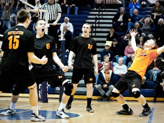 Northeastern boys' volleyball players Stephen Braswell, Luke Braswell, Chris Curry and Devin Soop react after scoring the match-winning point last season against Dallastown. (DAILY RECORD/SUNDAY NEWS -- FILE)