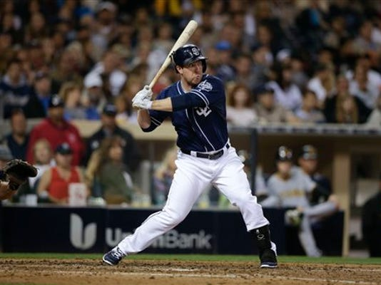 San Diego Padres' Jedd Gyorko bats against the Pittsburgh Pirates during the eighth inning of a baseball game Saturday, May 30, 2015, in San Diego. (AP Photo/Gregory Bull)