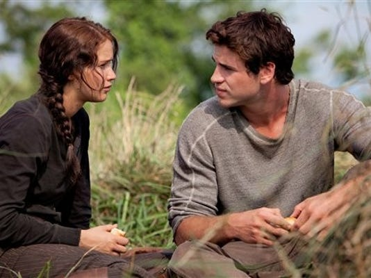 Jennifer Lawrence portrays Katniss Everdeen, left; and Liam Hemsworth portrays Gale Hawthorne in a scene from 'The Hunger Games.' (AP Photo / Lionsgate)
