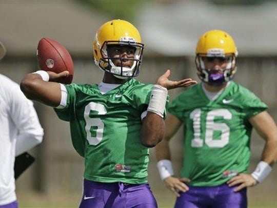 LSU quarterback Brandon Harris (6) works out during their NCAA college football practice in Baton Rouge.