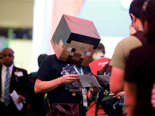 In this June 13, 2013 file photo, Jonny Rice wears a Minecraft-themed mask while promoting a video clip he created during the Electronic Entertainment Expo in Los Angeles.