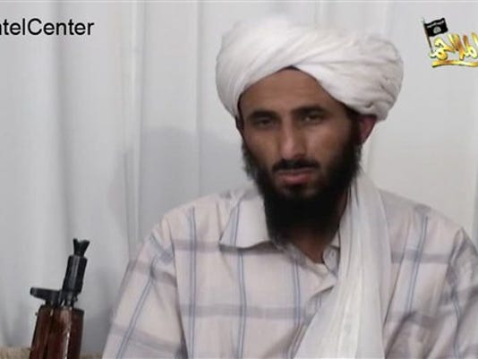 FILE - This image from video released Jan. 23, 2009, by al-Malahim Media Foundation and provided by IntelCenter on Dec. 30, 2009, shows the leader of Al-Qaida in the Arabian Peninsula, identified by the IntelCenter as Nasir al-Wahishi, in Yemen.