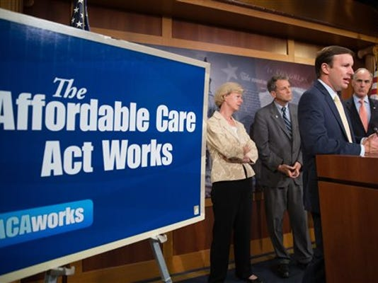 Sen. Chris Murphy, D-Conn., second from right, accompanied by Sen. Tammy Baldwin, D-Wisc., left, Sen. Sherrod Brown, D-Ohio, second from left, and Sen. Bob Casey, D-Pa., right, speaks at a press conference on the positive affects of the Affordable Care Act as the Senate convenes for a Sunday session on Capitol Hill in Washington, Sunday, July 26, 2015. On the Senate's agenda is an effort to repeal President Barack Obama's health care law. (AP Photo/Andrew Harnik)