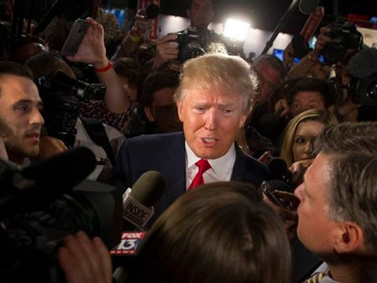 Republican presidential candidate Donald Trump speaks to the media in the spin room after the first Republican presidential debate at the Quicken Loans Arena Thursday, Aug. 6, 2015, in Cleveland.