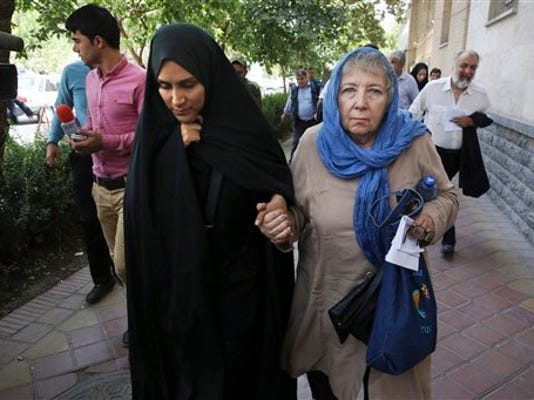 Mary Rezaian, mother of detained Washington Post correspondent Jason Rezaian, right, and Jason's wife Yeganeh leave a Revolutionary Court building in Tehran, Iran, Monday, Aug. 10, 2015. The final hearing of Rezaian detained in Iran more than a year ago and charged with espionage ended on Monday,with a verdict expected in the coming days in a trial that has been condemned by the newspaper and press freedom groups. (AP Photo/Vahid Salemi)