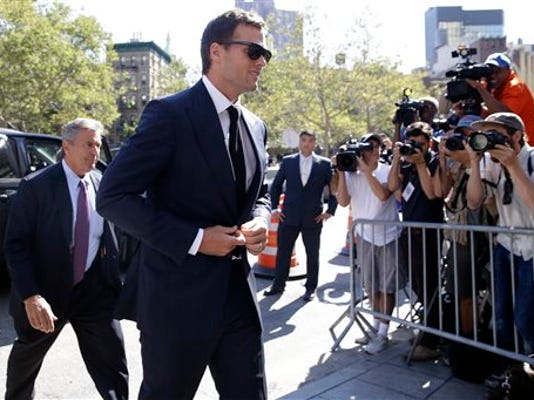 New England Patriots quarterback Tom Brady arrives at federal court, Wednesday, Aug. 12, 2015, in New York.