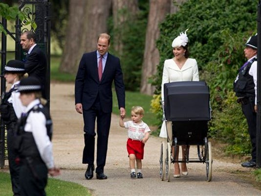 FILE- In this file photo dated Sunday, July 5, 2015, Britain's Prince William, Kate the Duchess of Cambridge, their son Prince George walk with their daughter Princess Charlotte in a pram, during an official media event as they arrive for Charlotte's Christening at St. Mary Magdalene Church in Sandringham, England.