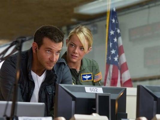 "This photo provided by Sony Pictures Entertainment shows, Bradley Cooper, left, and Emma Stone, in a scene from Columbia Pictures' ""Aloha."""