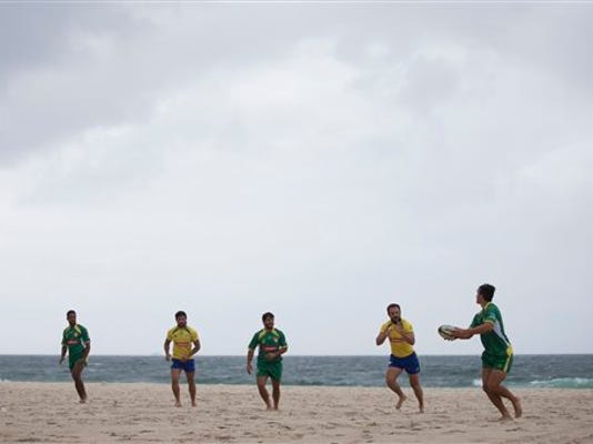 Brazilian athletes demonstrate plays during the inauguration of a Rugby pitch on Copacabana beach in Rio de Janeiro, Brazil, Wednesday, June 24, 2015.