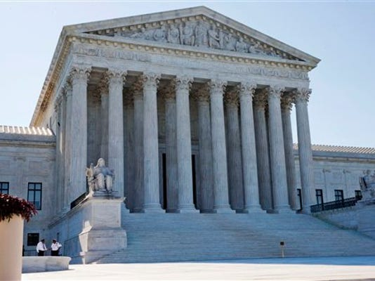 Members of security stand outside of the Supreme Court in Washington, Monday June 29, 2015.