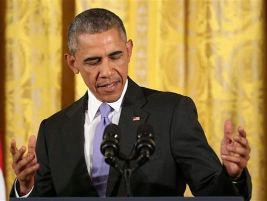President Barack Obama steps to the podium before making an opening statement during a news conference in the East Room of the White House in Washington, Wednesday, July 15, 2015. (AP Photo/Pablo Martinez Monsivais)