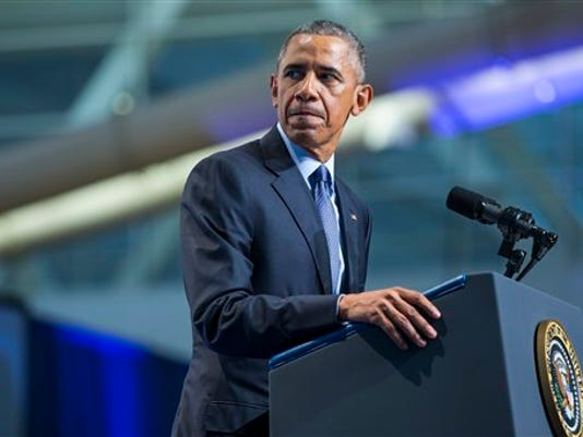 President Barack Obama pauses during a speech at the 116th National Convention of the Veterans of Foreign Wars, on Tuesday, July 21, 2015, in Pittsburgh.  Obama says the people criticizing the Iran nuclear deal are the same people who rushed into war with Iraq.  (AP Photo/Evan Vucci)