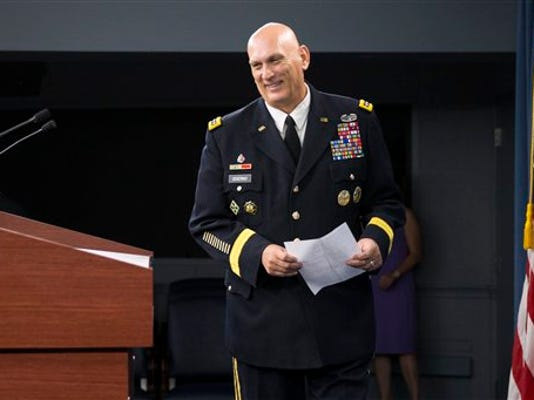 Outgoing Army Chief of Staff Gen. Ray Odierno arrives to speak at his final news briefing, Wednesday, Aug. 12, 2015, at the Pentagon.