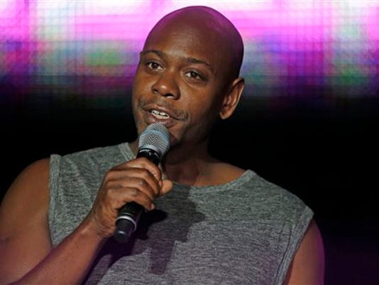 FILE - This Sunday, July 6, 2014 file photo, Dave Chappelle performs at the Essence Festival in New Orleans.