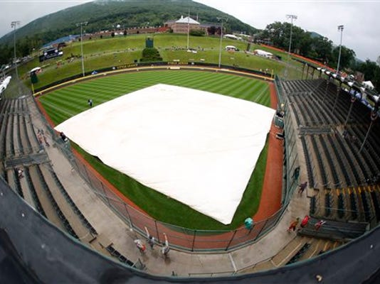 Rain falls on the covered field at Lamade Stadium Thursday in South Williamsport. The opening ceremony and the first day of four games of the Little League World Series tournament have been postponed because of rain. The tournament will resume play on Friday with eight games being played.