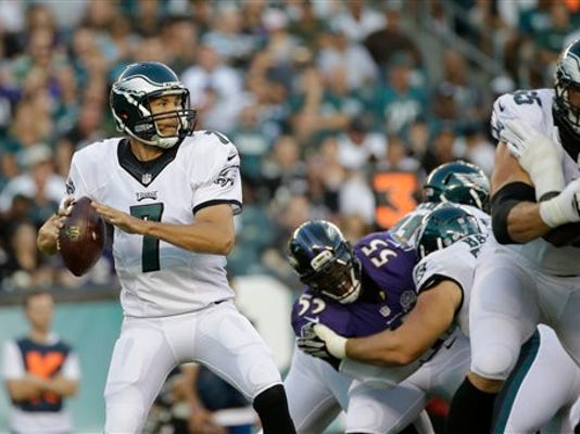 Philadelphia's Sam Bradford looks to pass during the first half of a preseason game against the Baltimore Ravens on Saturday in Philadelphia.