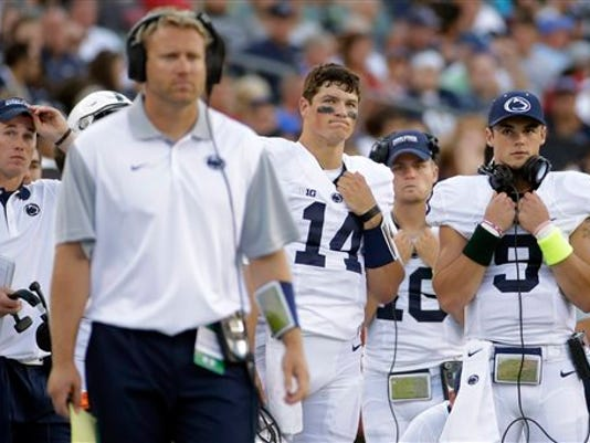 Penn State quarterbacks Christian Hackenberg (14), Billy Fessler (16) and Trace McSorley (9) watch from the sidelines during the second half of the Nittany Lions' 27-10 loss to Temple on Saturday.