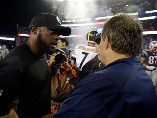 Pittsburgh Steelers head coach Mike Tomlin, left, speaks with New England Patriots head coach Bill Belichick after the Patriots' 28-21 win on Thursday in Foxborough, Massachusetts.