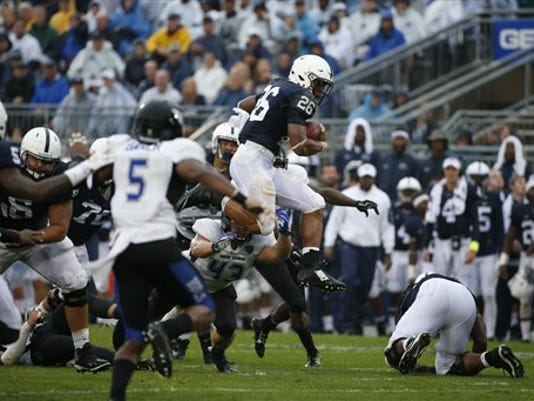 Penn State running back Saquon Barkley (26) leaps over a Buffalo defender during the second half on Saturday State College.