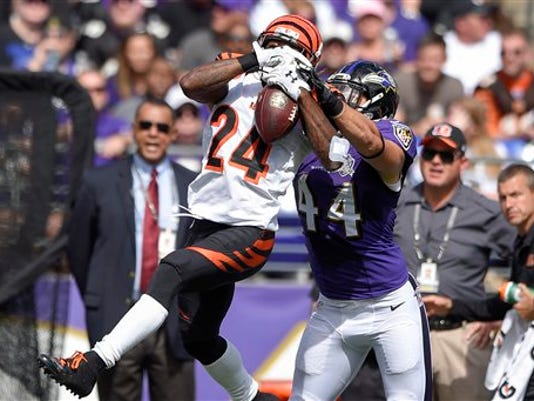 Cincinnati Bengals cornerback Adam Jones (24) intercepts a pass intended for Baltimore Ravens fullback Kyle Juszczyk (44) during the first half of an NFL football game in Baltimore, Sunday, Sept. 27, 2015.