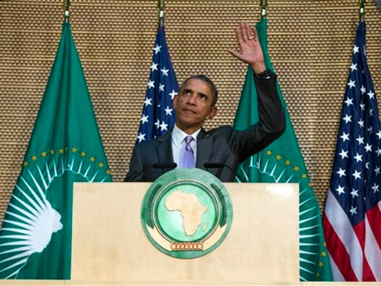 U.S. President Barack Obama waves as he arrives to deliver a speech to the African Union, Tuesday, July 28, 2015, in Addis Ababa, Ethiopia. On the final day of his African trip, Obama is focusing on economic opportunities and African security.