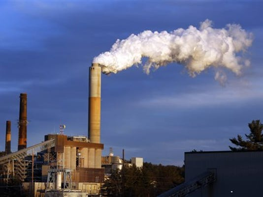 FILE - In this Jan. 20, 2015 file photo, a plume of steam billows from the coal-fired Merrimack Station in Bow, N.H. President Barack Obama, on Monday, Aug. 3, 2015, unveiled the final version of his unprecedented regulations clamping down on carbon dioxide emissions from existing U.S. power plants. The Obama administration first proposed the rule last year. Opponents plan to sue immediately to stop the rule's implementation.