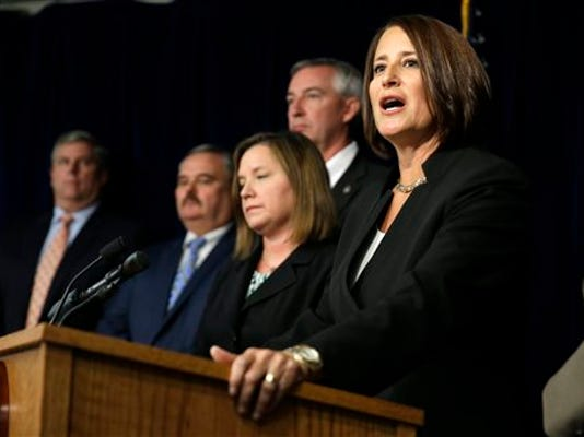 Montgomery County District Attorney Risa Vetri Ferman announces charges against Attorney General Kathleen Kane on Thursday.
