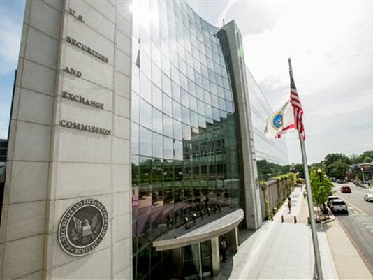 This June 19, 2015 photo shows the U.S. Securities and Exchange Commission building, in Washington. The Securities and Exchange Commission is scheduled to vote Wednesday, Aug. 5, 2015, to formally adopt a rule compelling public companies to report the ratio between their chief executive's annual compensation and the median, or midpoint, pay of employees.