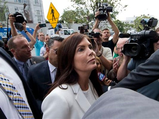 Pennsylvania Attorney General Kathleen Kane arrives to be processed and arraigned on charges she leaked secret grand jury material and then lied about it under oath, Saturday, Aug. 8, 2015, at the Montgomery County detective bureau in Norristown, Pa. Kane, the state s first elected female attorney general, vows to fight the charges, which include perjury, obstruction and conspiracy.