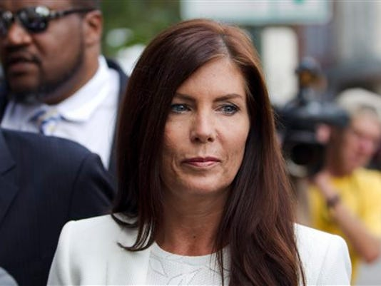 In this Aug. 8, 2015, file photo, Pennsylvania Attorney General Kathleen Kane arrives to be processed and arraigned on charges she leaked secret grand jury material and then lied about it under oath at the Montgomery County detective bureau in Norristown, Pa. Kane has scheduled a news conference for Wednesday, Aug. 12, at the state Capitol to publicly discuss the criminal charges leveled against her last week in connection with an alleged political payback scheme.