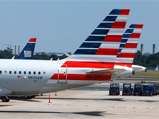 American Airlines planes wait on the tarmac at Washington's Reagan National Airport after technical issues at a Federal Aviation Administration center in Virginia caused delays on Saturday, Aug. 15, 2015. (AP Photo/Jacquelyn Martin)