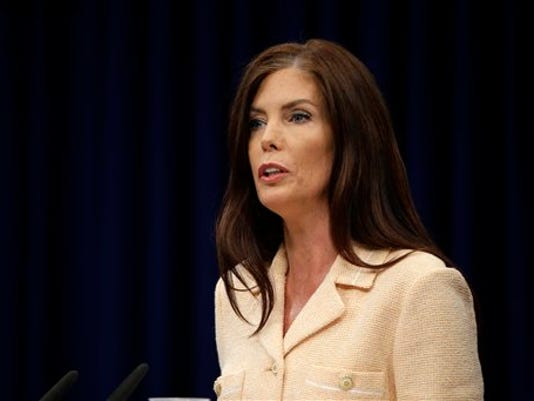 Pennsylvania Attorney General Kathleen Kane speaks during a news conference Wednesday, Aug. 12, 2015, at the state Capitol in Harrisburg, Pa. Kane said Wednesday that criminal charges against her are part of an effort by state prosecutors and judges to conceal pornographic and racially insensitive emails they circulated with one another. Kane is charged with leaking grand jury information to a newspaper reporter as payback to a former state prosecutor and then lying about it under oath.