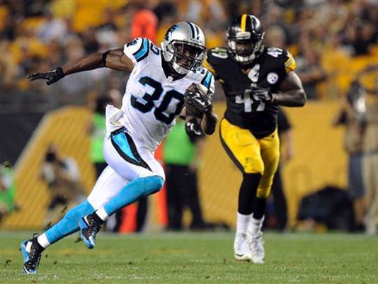Carolina Panthers running back Jordan Todman (30) dashes past Pittsburgh Steelers linebacker Shayon Green (49) on his way to a touchdown during the second quarter of an NFL preseason football game, Thursday, Sept. 3, 2015, in Pittsburgh.