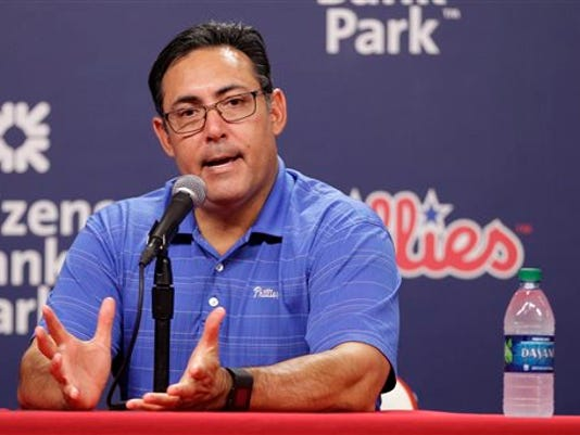 Philadelphia Phillies Senior Vice President & General Manager Ruben Amaro Jr. takes questions from the media after trading starting pitcher Cole Hamels prior to the first inning of a baseball game against the Atlanta Braves, Friday, July 31, 2015, in Philadelphia.