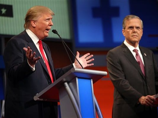 Republican presidential candidate Donald Trump speaks as Jeb Bush watches during a Republican presidential debate in August in Cleveland. Eleven top-tier Republican presidential hopefuls face off in their second prime-time debate of the 2016 campaign Sept. 16.