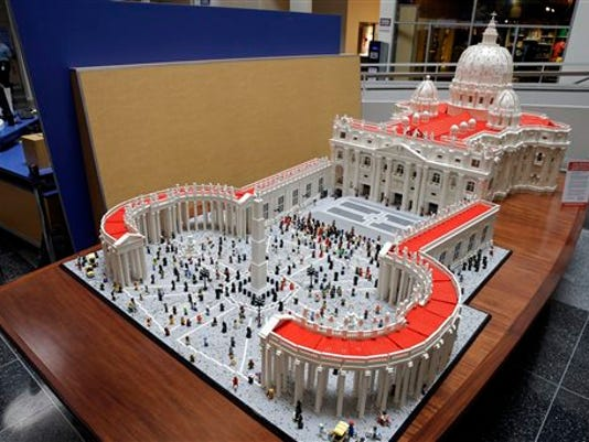 In this Friday, Sept. 11, 2015 photo, shown is a Lego representation of the St. Peter s basilica and square, at The Franklin Institute in Philadelphia. The Rev. Bob Simon spent about 10 months building it with approximately half-a-million Legos.