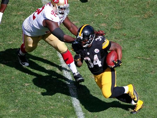 Pittsburgh Steelers running back DeAngelo Williams (34) runs away from San Francisco 49ers defensive end Quinton Dial (92) for a gain in the fourth quarter of an NFL football game, Sunday, Sept. 20, 2015 in Pittsburgh. The Steelers won 43-18.