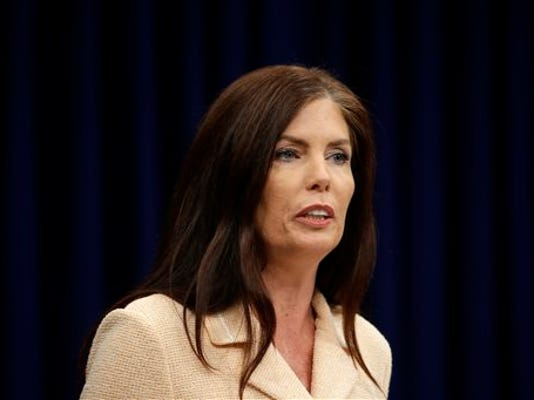 In this  Aug. 12, 2015 file photo Pennsylvania Attorney General Kathleen Kane speaks during a news conference at the state Capitol in Harrisburg, Pa.   Kane faces a new charge Thursday, Oct. 1, 2015 that stems from evidence found during an execution of a search warrant at her office Sept. 17. Kane was previously charged with perjury, conspiracy and other counts. Prosecutors say she leaked confidential information from a 2009 grand jury probe and then tried to cover it up.