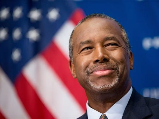 In this Oct. 9, 2015 photo, Republican presidential candidate Dr. Ben Carson speaks at a luncheon at the National Press Club in Washington. In the past week, Republican presidential candidate Ben Carson has suggested the Holocaust wouldn't have happened if Jews in Europe were better armed, said gun control is a bigger tragedy than a bullet-riddled body and that the best way to confront a mass shooter is to rush the gunman.