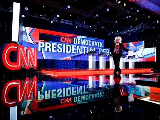 Michelle Poley walks on stage before a CNN Democratic presidential debate, Tuesday, Oct. 13, 2015, in Las Vegas. Democratic presidential candidates, Hillary Rodham Clinton, Jim Webb, Bernie Sanders, Lincoln Chafee, and Martin O'Malley will take the stage later today.