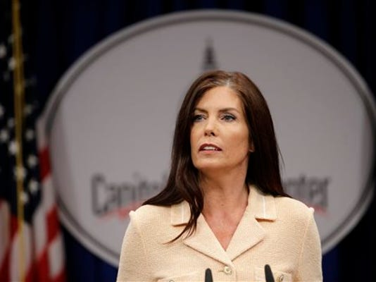 FILE - In this Aug. 12, 2015, file photo, Pennsylvania Attorney General Kathleen Kane speaks during a news conference at the state Capitol in Harrisburg, Pa. Pennsylvania's highest court on Monday, Sept. 21, ordered the temporary suspension of Kane's law license, a step that could trigger efforts to remove her from office as she fights perjury, obstruction and other charges.