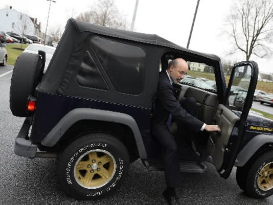 Even if Gov. Tom Wolf is driving his Jeep to public appearances - or paying for the travel himself - his trips around the state to push his budget send an inconsistent message.