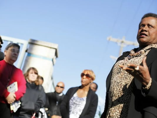 Joanne Borders, a community resource liaison with the York City police, addresses about 20 members of the community who gathered at a rally against crime that Borders organized at the intersection of West King and South West Streets on Thursday, Oct. 6, 2011.