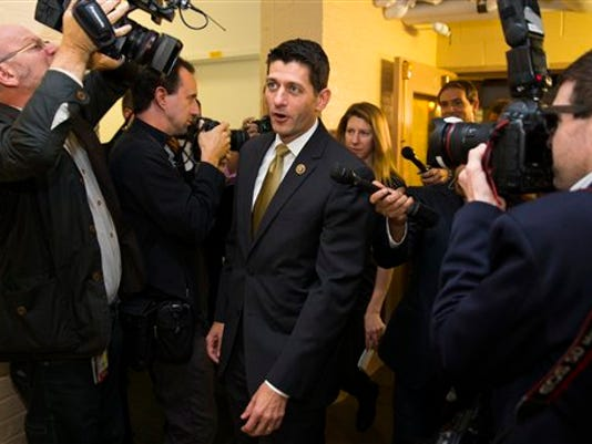 Rep. Paul Ryan, R-Wis. is surrounded by media as he arrives for a House GOP conference meeting on Capitol Hill in Washington, Wednesday, Oct. 21, 2015. Ryan is seeking unity in a place it's rarely found, telling House Republicans he will serve as their speaker only if they embrace him by week's end as their consensus candidate.