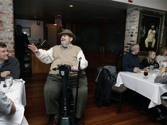 Chef Paul Prudhomme gestures as he greets guests at his French Quarter restaurant, K-Paul's Louisiana Kitchen, in New Orleans, Friday, Feb. 2, 2007.
